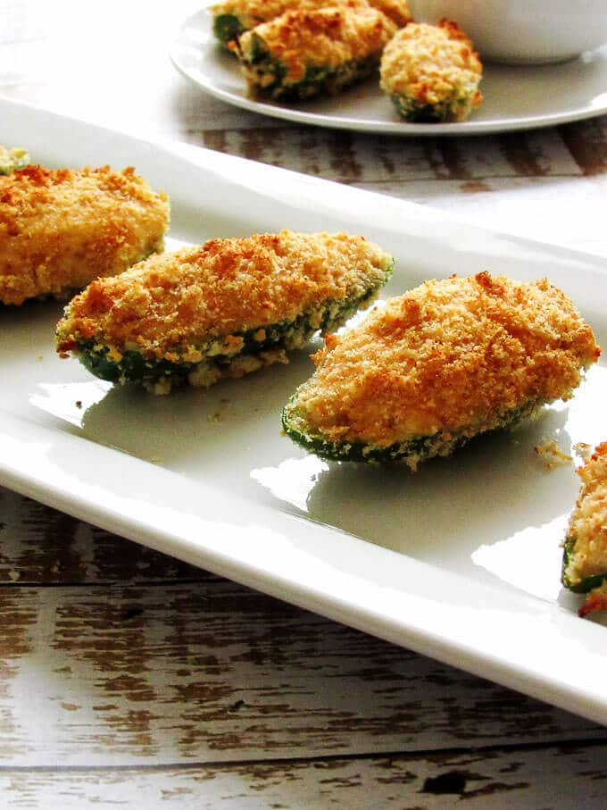 Healthier Jalapeno Poppers in a row on a white serving platter.