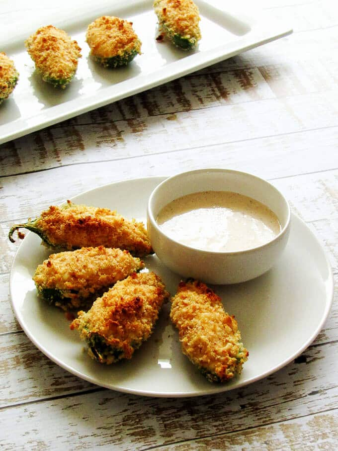 Four Healthier Jalapeno Poppers on a dish.