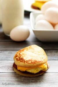 Single Ham Egg & Cheese Pancake Slider in front of a bowl of eggs.