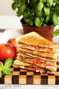Stack of Grilled Cheese Margarita with fresh tomatoes.