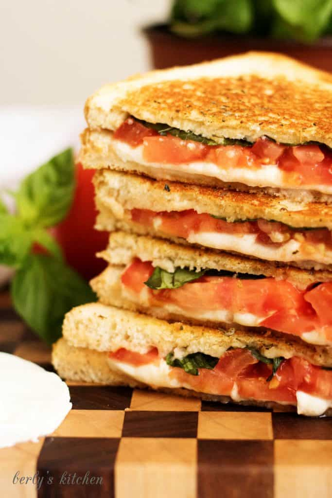 A margherita grilled cheese sandwich with perfectly toasted sourdough and all the flavors of the famous pizza including basil, mozzarella, and tomatoes.