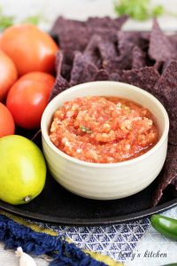 Mild Serrano Pepper Salsa with fresh lime, tomatoes and blue chips.