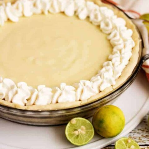 A homemade silky smooth key lime pie that's creamy, sweet, and tangy and is prepared with authentic key lime juice. It's the perfect for pie Spring!