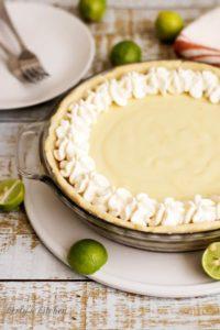 Key Lime Pie in a glass pie pan.