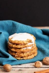 Stack of Spiced and Iced Oatmeal Cookies on a blue napkin.