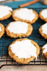 Spiced and Iced Oatmeal Cookies on a cooling rack.