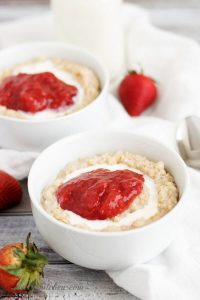 Strawberries and Cream Steel Cut Oatmeal in two bowls with a white towel.