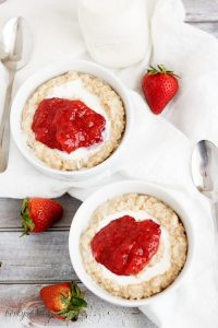 Top down view of Strawberries and Cream Steel Cut Oatmeal with fresh strawberries.