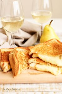 Grilled Brie and Pear Sandwich with white wine.