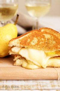 Close up of Grilled Brie and Pear Sandwich with melted cheese.