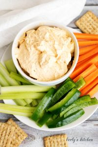 Top down view of Creamy Buffalo Cheese Spread with fresh vegetables.