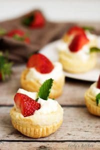 Several Strawberry Key Lime Cups with fresh strawberries and mint.