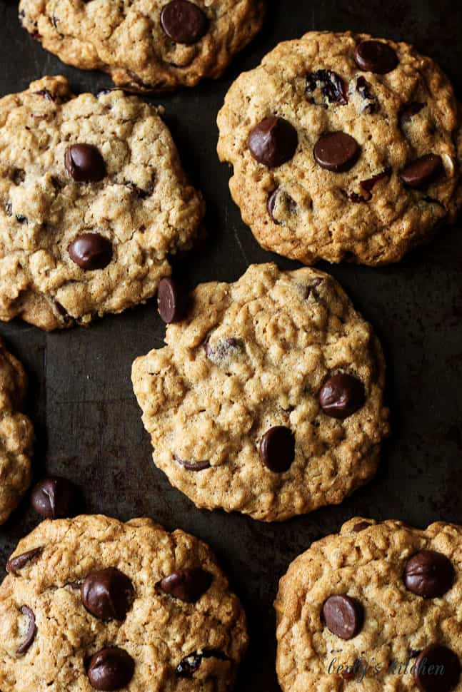 Top down view of Cranberry Dark Chocolate Chip Oatmeal Cookies on baking sheet.