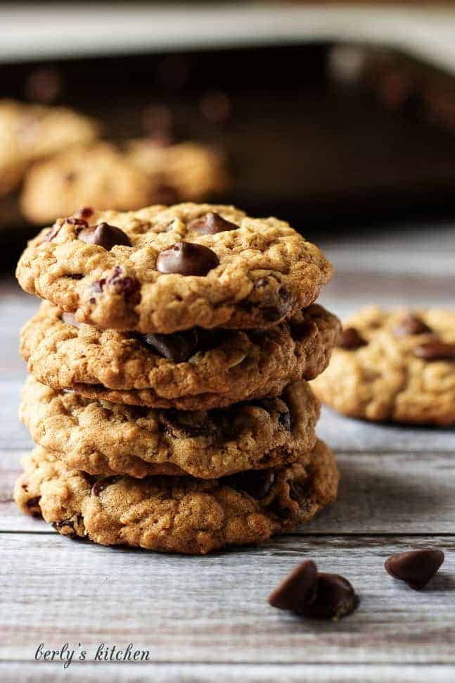 Stack of four Cranberry Dark Chocolate Chip Oatmeal Cookies.