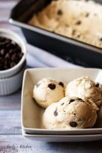 Coffee ice cream with chocolate chips in the background.