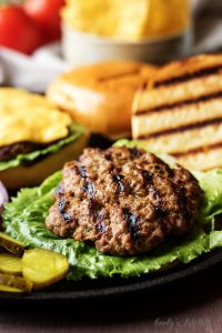 Onion Burgers open-faced with a grilled bun.