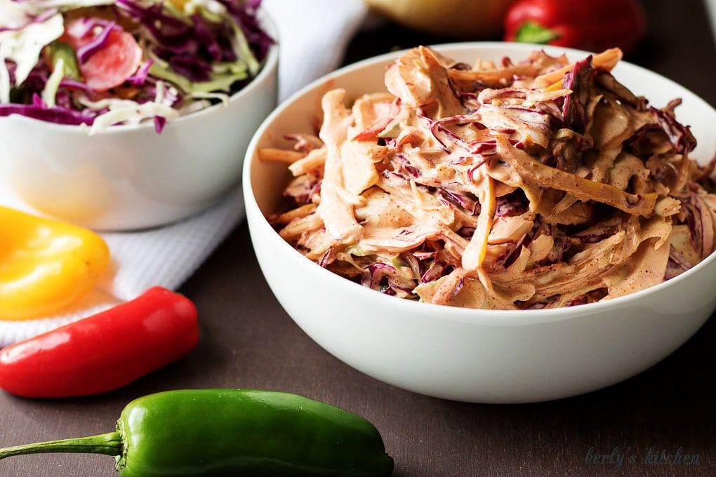 Spicy coleslaw recipe with multi-colored recipes and plain coleslaw.