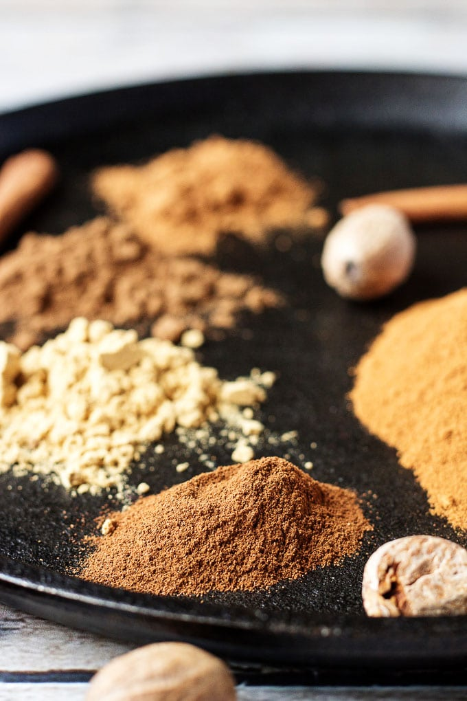 Ground spices on circular cast iron skillet.