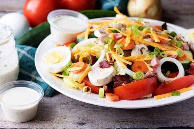 Diner chef salad with a side of ranch dressing.