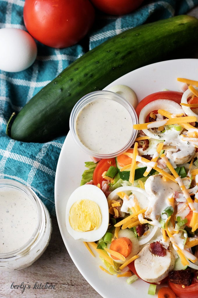 Salad covered with ranch dressing.