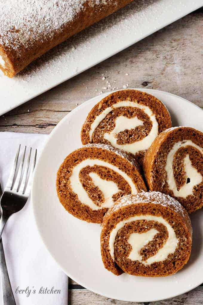 Grandma's Pumpkin Roll is one of my family's favorite fall recipes.  Sweetened cream cheese filling rolled in a light, and moist pumpkin cake makes this dessert unforgettable.