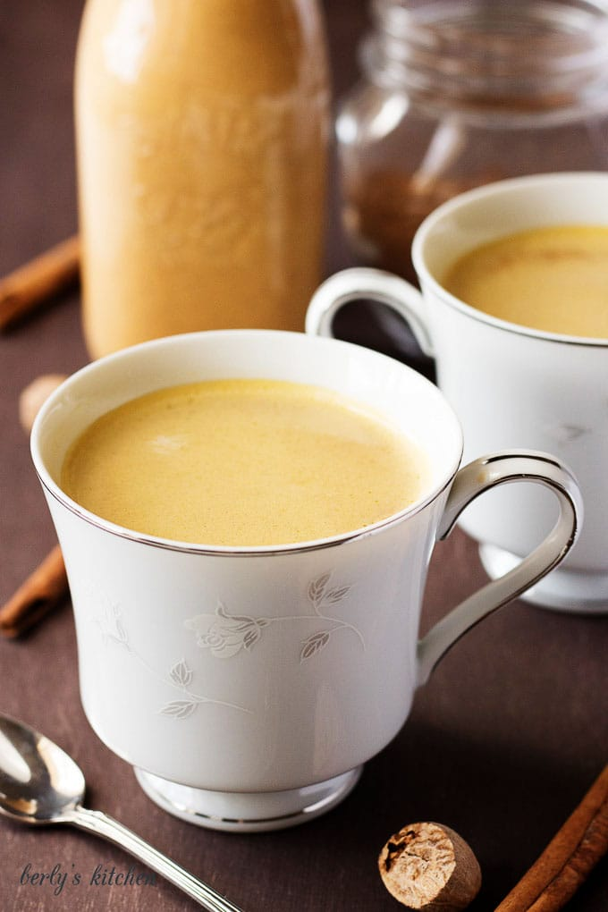 Two cups filled with the pumpkin coffee.