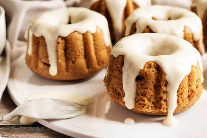 Mini pumpkin bundt cakes with spoon on a plate.
