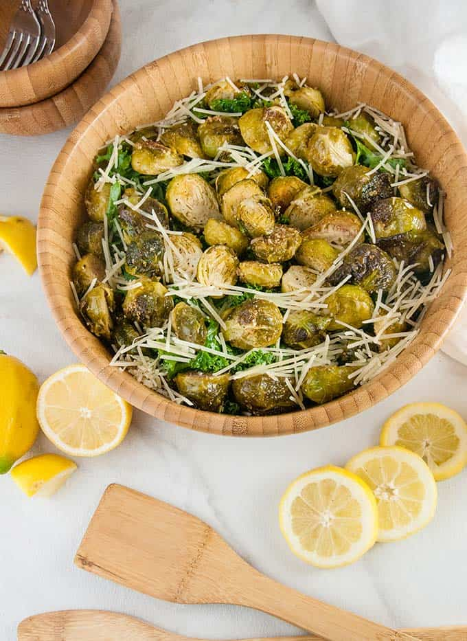 Brussels sprouts Caesar salad in a large wooden bowl.