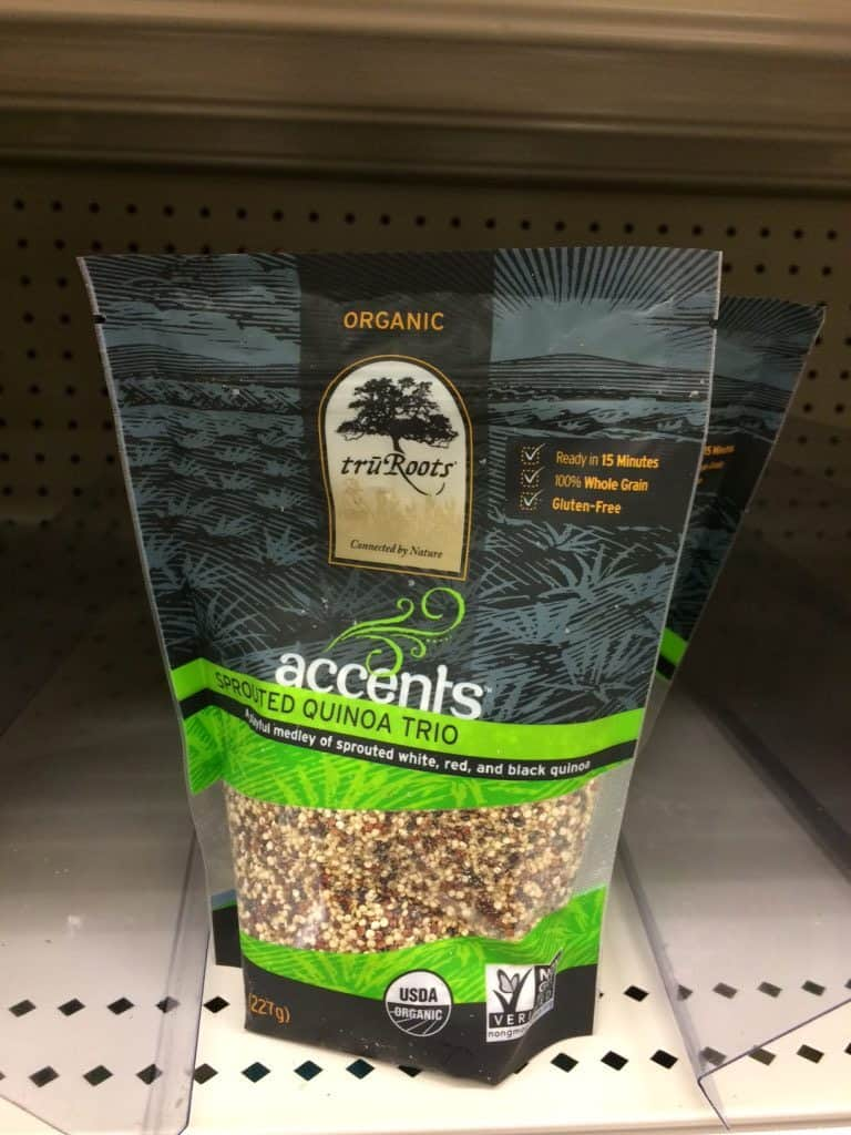 Package of tru Roots quinoa on a shelf in the grocery store.