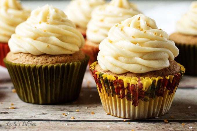 Spiced cupcakes topped with gold sprinkles.