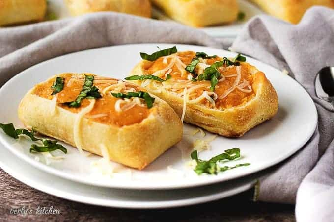 Dinner rolls used as soup bowls with tomato soup.