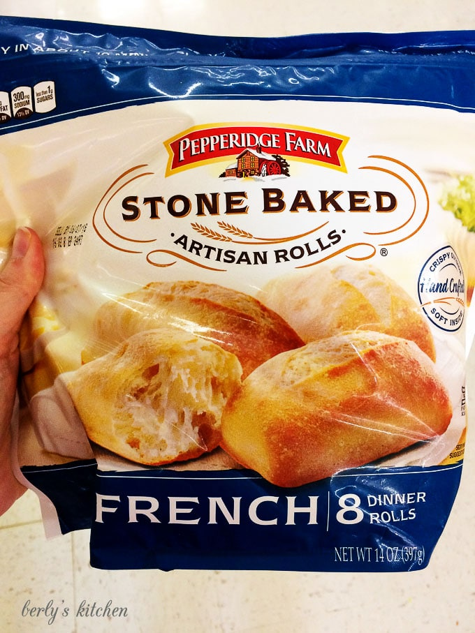 Picture of dinner rolls in freezer section of store.