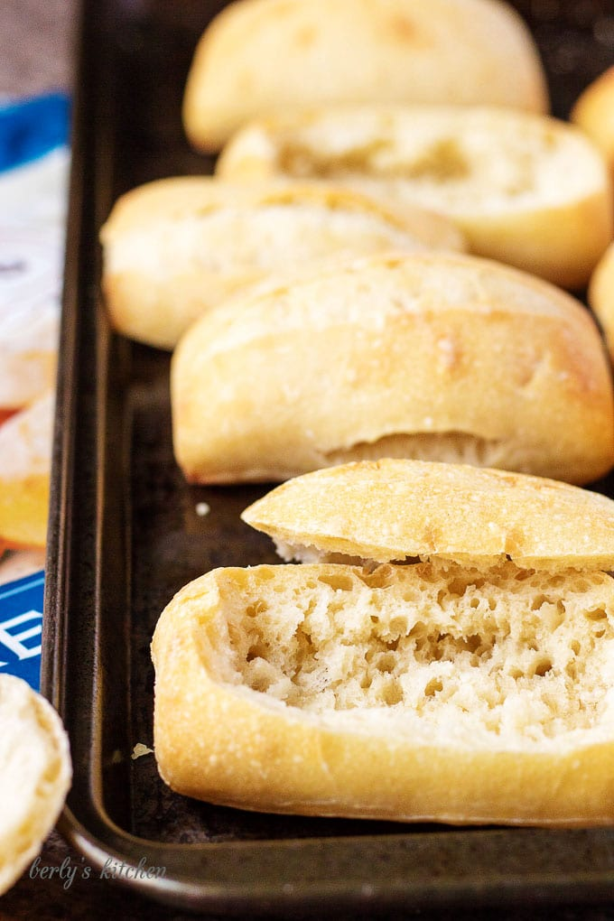 Picture of dinner rolls hollowed out for bread bowls.