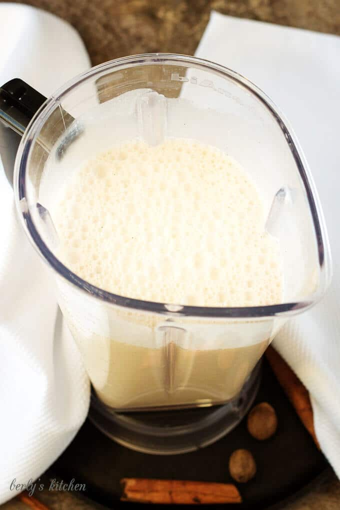 The mixed coquito recipe in a blender, just before being chilled.
