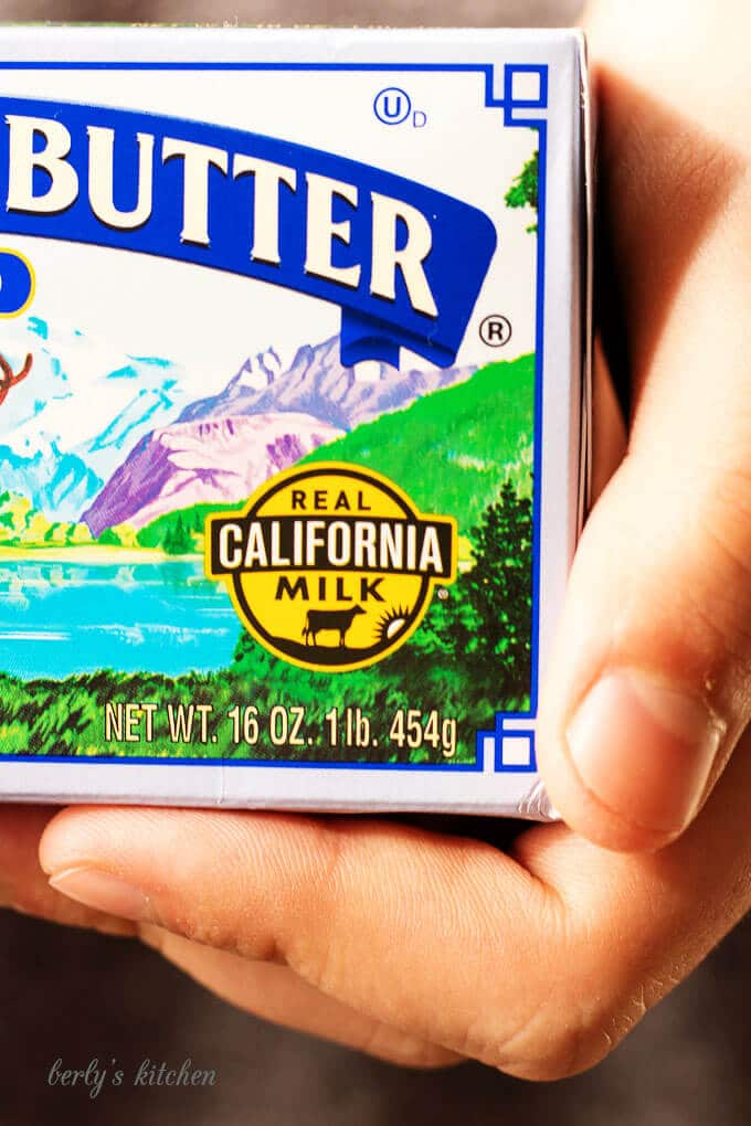 A zoomed in view of the Real California Milk seal being held by a person.