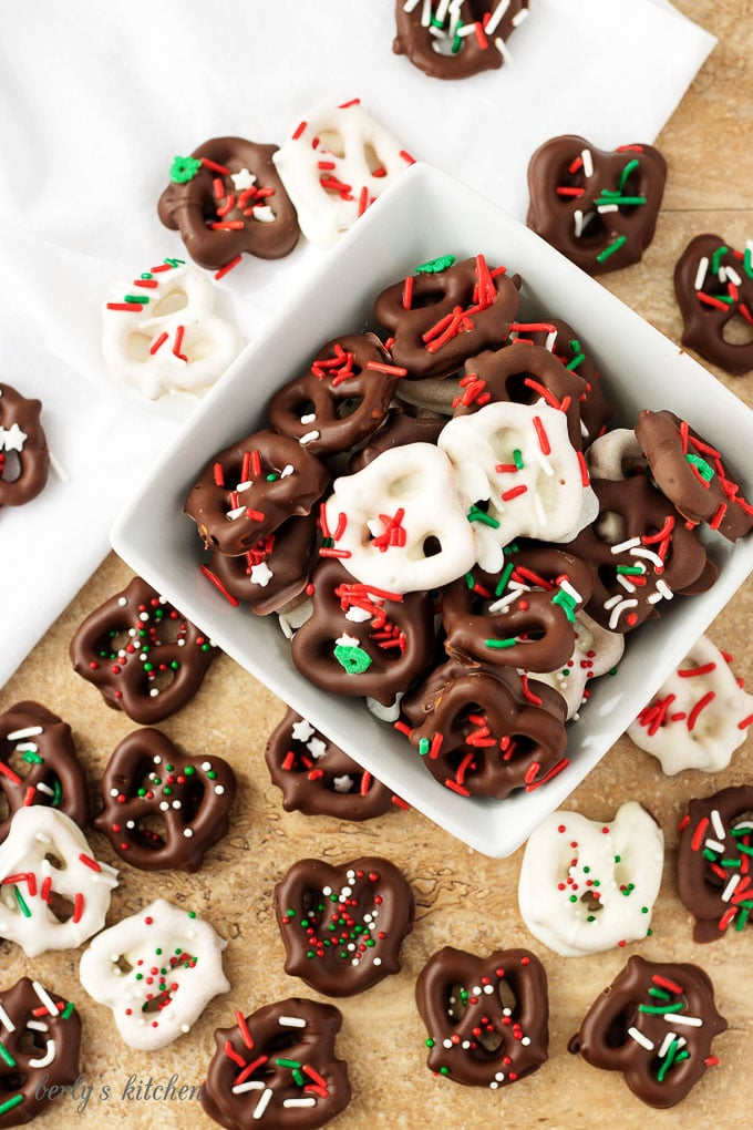 The final top-down view of the white and dark chocolate dipped pretzels in a white bowl.