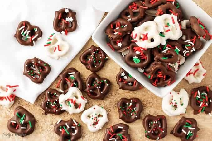Top-down view of the chocolate covered pretzels recipe , white and dark chocolate dipped pretzels with sprinkles.