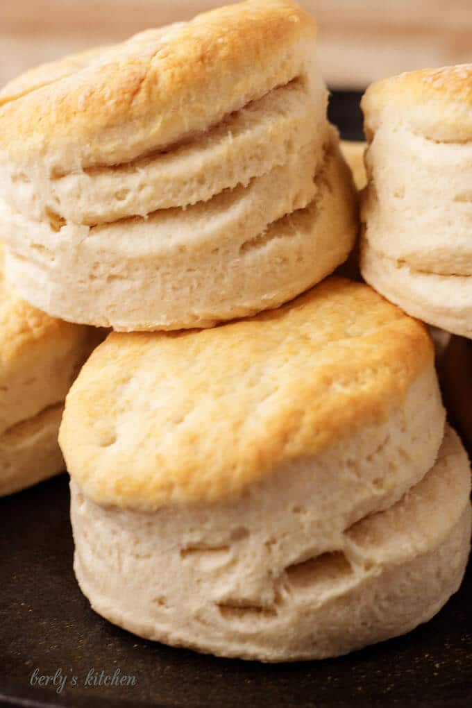 Stack of fluffy homemade buttermilk biscuits.