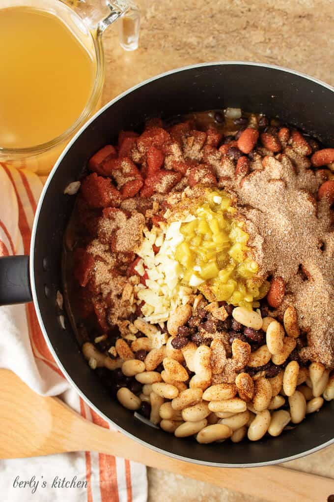 Aerial photo of the three bean chili and spices cooking in a pot.