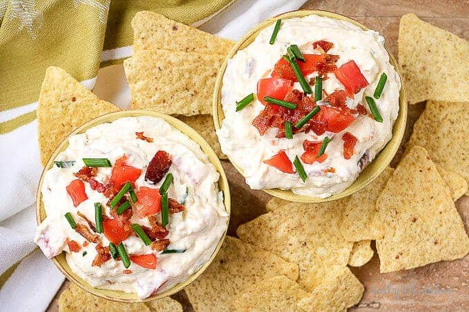 An aerial photo of the finished blt dip garnished with diced tomatoes and green onions.