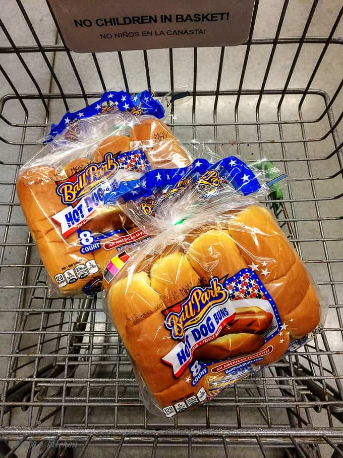 The hot dog buns in our shopping cart at Walmart.