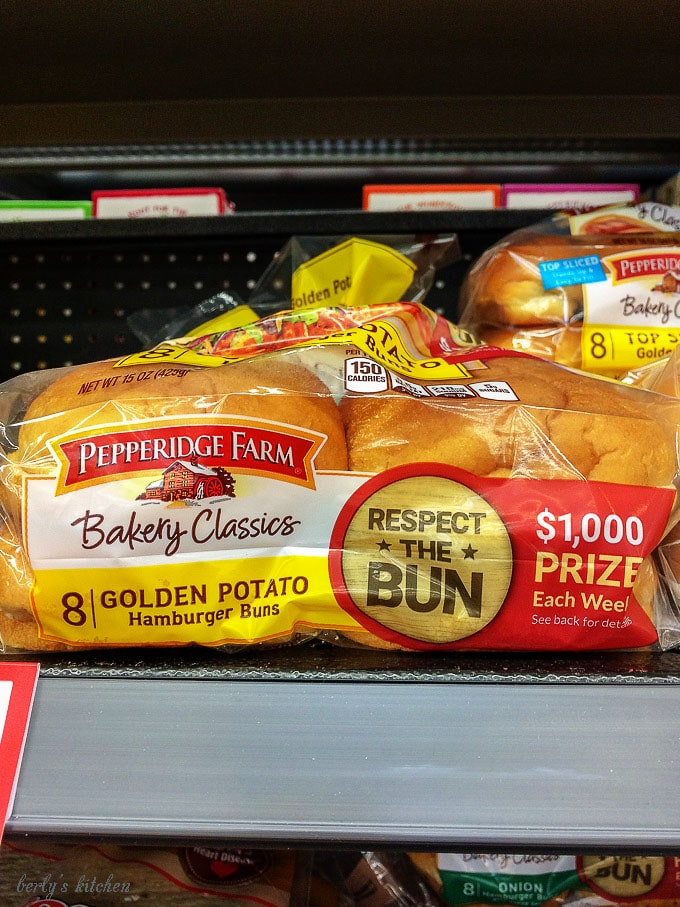 The bakery classic buns sitting on the shelf at our local store.