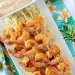 A top-down photo of the grilled shrimp over a bed of cilantro rice, served with key lime aioli.