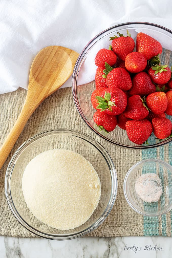 An aerial photo of the four ingredients used in the strawberry sauce.