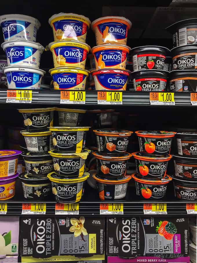The Oikos Greek Yogurt on this shelves at Walmart highlighting the flavors available for purchase.