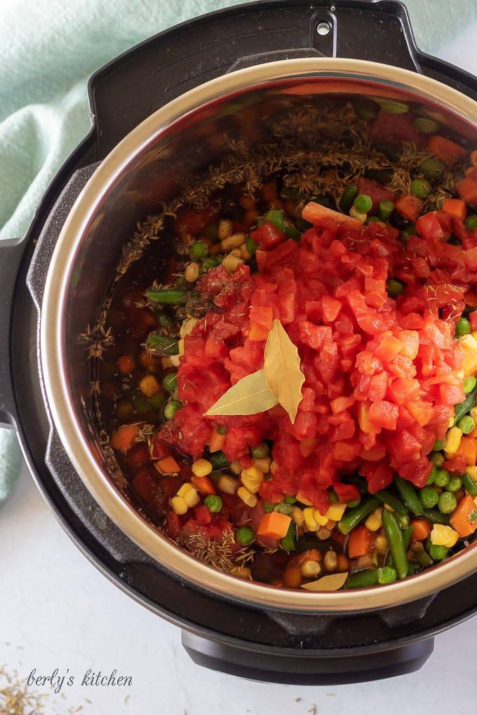 The vegetable beef soup ingredients in the instant pot, prepped for cooking.
