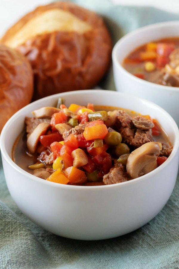 Our instant pot vegetable beef soup is a simple, yet filling Fall dish that combines stew meat with frozen veggies and is ready to eat in less than an hour. #food #soup #Fall #dinner #beef