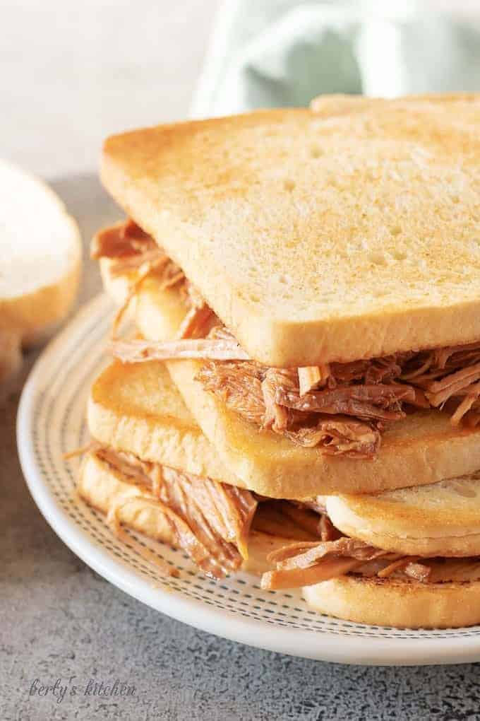 A close-up photo of the slow cooker pulled pork on toasted bread.