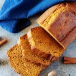 The finished pumpkin bread recipe loaf cut into thick serving slices.