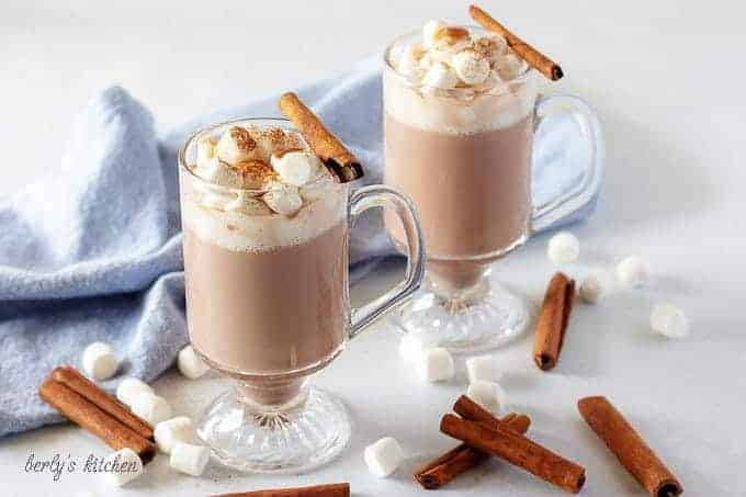 The finished spiked hot cocoa in a glass mug, topped with marshmallows.